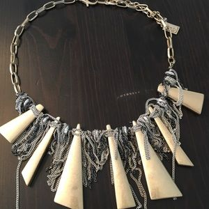 Gold and silver metal and chain necklace.